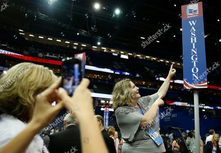 Lisa Wagner Lisa Wagner from Walla Walla, Wash. poses for a picture on the floor of the Republican National Convention in Tampa, Fla., on