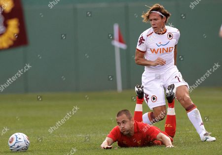 Rodrigo Taddei, Joe Cole Liverpool's Joe Cole (10) falls to the pitch after being pushed by Roma midfielder Rodrigo Taddei (11) during the first half of a friendly soccer match at Fenway Park in Boston