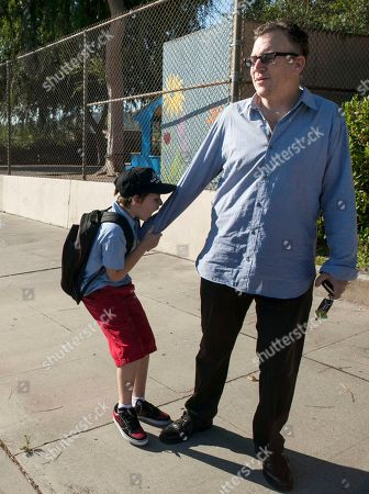 Stock Image of Will Asner, Matthew Asner Will Asner, 9, who is autistic, tries to bite into his father's grip, as they walk together to the Nestle Avenue Elementary School in the Tarzana district of Los Angeles. Public school districts are seeing higher proportions of children with special needs due to declining enrollment and charter schools that do not accept as many kids with disabilities, especially more severe disabilities. This raises a question of equitable access for these kids, as well as cost issues for school districts