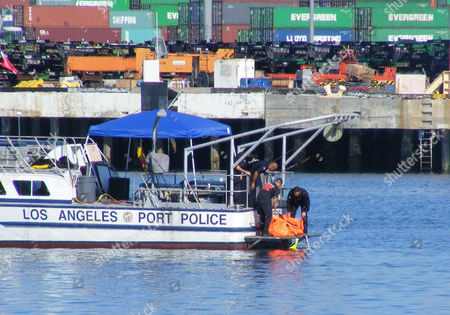 "Los Angeles Port Police pull the body of Tony Scott from the water beneath the Vincent Thomas Bridge in San Pedro, Calif. Scott, director of such Hollywood blockbusters as ""Top Gun,"" ''Days of Thunder"" and ""Beverly Hills Cop II,"" has died after jumping from the bridge"