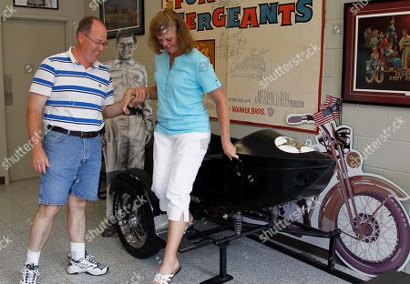 Kevin Mixon helping his wife Donna Gail Mixon, of Walterboro, S.C., from a sidecar in the Andy Griffith Museum in Mount Airy, N.C. Tourism in Mount Airy is up since Andy Griffith died July 3, with about 10,400 people visiting the Andy Griffith Museum in July, almost double the 5,400 who visited in July 2011