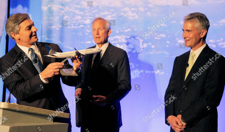 Jeff Smisek, Jim McNerney, Ray Conner Boeing Commercial Airplanes CEO Ray Conner, presents a model of Boeing's new 737 Max 9 to United Airlines CEO Jeff Smisek, right, during a news conference as Boeing CEO Jim McNerney looks, in Chicago. United Airlines and Boeing announce that United is buying 150 Boeing 737s, and is planning to use them to replace older planes that are not as fuel efficient