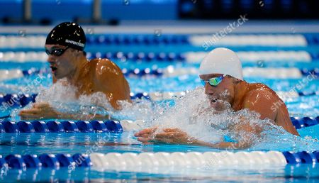 Eric Shanteau, Clark Burckle Eric Shanteau, left, and Clark Burckle swim in a men's 200-meter breaststroke semifinal at the U.S. Olympic swimming trials, in Omaha, Neb