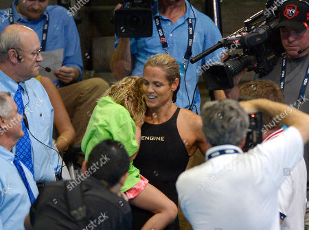 Dara Torres Dara Torres is surrounded by photographers after swimming in the women's 50-meter freestyle final at the U.S. Olympic swimming trials, in Omaha, Neb. Jessica Hardy won the final