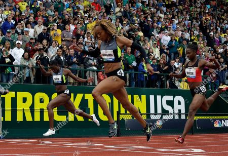 Sanya Richards-Ross, Jeneba Tarmoh and Tianna Madison cross the finish line during the women's 200 meter final at the U.S. Olympic Track and Field Trials, in Eugene, Ore