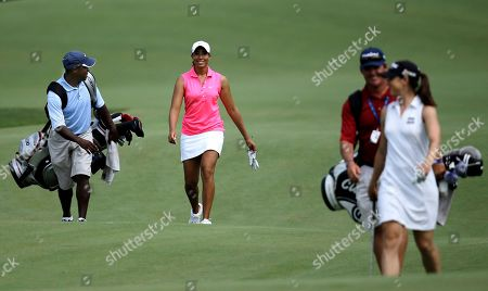 Cheyenne Woods, second from left, walks up the 12th fairway with Paige Mackenzie during a practice round for the U.S. Women's Open golf tournament, in Kohler, Wis