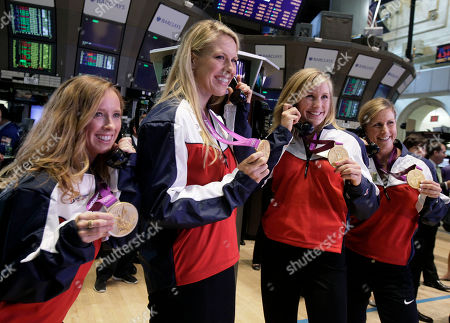 Mary Whipple, Meghan Mushnicki, Erin Cafaro, Esther Lofgren U.S. women's rowing eight Olympic gold medalists from left: Mary Whipple, Esther Lofgren, Meghan Mushnicki, and Erin Cafaro, pose for photos as they visit the trading floor of the New York Stock Exchange, after ringing the opening bell