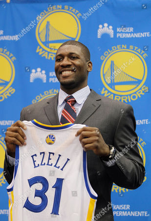 Festus Ezeli Golden State Warriors second draft pick Festus Ezeli, a center from Vanderbilt, holds up his new jersey during a news conference at Warriors headquarters in Oakland, Calif