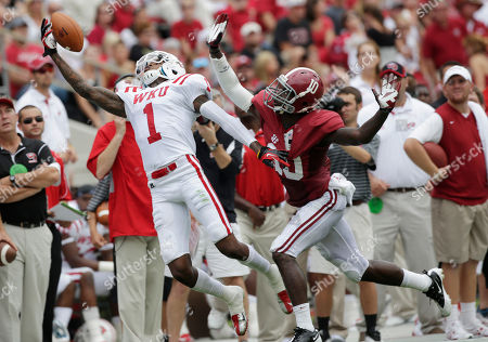 Jonathan Dowling, John Fulton Western Kentucky defensive back Jonathan Dowling (1) can't haul in a first quarter pass as Alabama defensive back John Fulton (10) defends in an NCAA college football game at Bryant Denny Stadium in Tuscaloosa, Ala