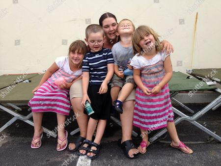 Simone Covey This photo shows Simone Covey, center, a 26-year-old single mother of three, sitting on a cot with her children and nephew at a Red Cross shelter in Colorado Springs, Colo., where they are staying after the Waldo Canyon Fire forced them from their home. Covey doesn't know if the apartment was damaged by the fire, which has destroyed hundreds of homes and has so far forced mandatory evacuations for more than 32,000 residents. Pictured from left to right are Emma Covey, 6; Covey's nephew, Zack Miller, 5; Simone Covey; Logan Thompson-Covey, 2 and Nyomie Covey, 5