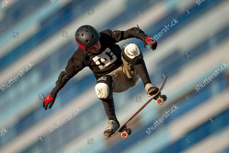 Tom Schaar Tom Schaar, of Malibu, Calif., spins during warm-ups before the first heat of the Skateboard Big Air event at the X Games, in Los Angeles