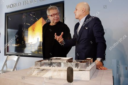 Daniel Libeskind, Ronald Perelman, Ronald O. Perelman Performing Arts Center World Trade Center Planner Daniel Libeskind, left, talks with Ronald Perelman beside a scale model of the Ronald O. Perelman Performing Arts Center, at the World Trader Center site, during the official design unveiling in New York, . The center, scheduled to open in 2020, will be shaped like a cube and made out of translucent marble. It will have three theaters with moveable walls that could be reconfigured for works of dance, opera, music and theater