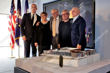 Joshua Prince-Ramus, Maggie Boepple, Larry Silverstein, Daniel Libeskind, Ronald Perelman, Ronald O. Perelman Performing Arts Center Designer and Architect Joshua Prince-Ramus; President & Director of The Perelman Center Maggie Boepple; Developer Larry Silverstein; World Trader Center Planner Daniel Libeskind; and Ronald Perelman, left to right, pose for photos with a scale model of the Ronald O. Perelman Performing Arts Center, during the official design unveiling in New York, . The center, scheduled to open in 2020 at the Worls Trader Centr site, will be shaped like a cube and made out of translucent marble. It will have three theaters with moveable walls that could be reconfigured for works of dance, opera, music and theater
