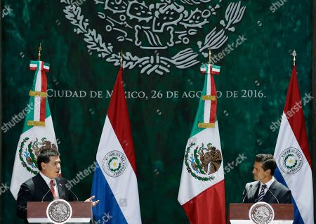 Enrique Pena Nieto, Horacio Cartes Jara Mexican President Enrique Pena Nieto, right, listens to Paraguay's President Horacio Cartes during a joint statement to the press following the signing of bilateral agreements, at the National Palace in Mexico City