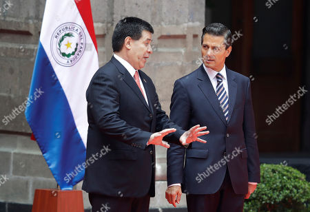 Enrique Pena Nieto, Horacio Cartes Jara Mexican President Enrique Pena Nieto, right, speaks with Paraguay's President Horacio Cartes Jara during an offical welcome cermony at the National Palace in Mexico City
