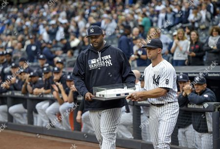 CC Sabathia, Brett Gardner New York Yankees' CC Sabathia, left, and Brett Gardner carry an autographed base to be presented to Mark Teixeira as a gift for his retirement during a ceremony before baseball game against the Baltimore Orioles, in New York