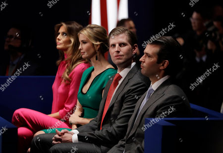 Melania Trump, from left, Ivanka Trump, Eric Trump and Donald Trump, Jr. wait for the second presidential debate between Republican presidential nominee Donald Trump and Democratic presidential nominee Hillary Clinton at Washington University, in St. Louis