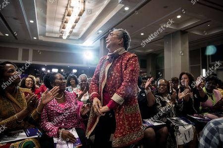 Sheila Jackson Lee, Marian Wright Edelman Children's Defense Fund President and founder Marian Wright Edelman, center, accompanied by Rep. Sheila Jackson Lee, D-Texas, second from left, stands as she is acknowledged by Democratic presidential candidate Hillary Clinton as she speaks at the Black Women's Agenda's 29th Annual Symposium at the Renaissance Washington, D.C. Downtown Hotel, in Washington