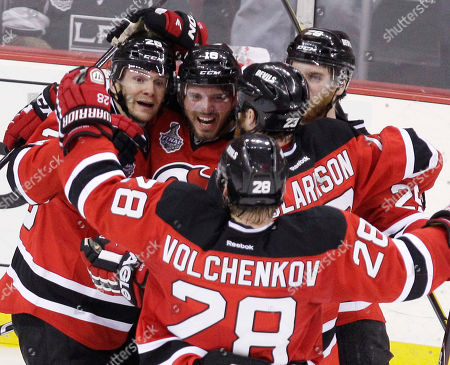 Patrik Elias UPDATES WITH CHANGE TO PERSON SCORING GOAL - New Jersey Devils' Patrik Elias, left, of the Czech Republic, and Anton Volchenkov (28) celebrate with teammates after Volchenkov scored a goal against the Los Angeles Kings during the second period of Game 1 of the NHL hockey Stanley Cup finals, in Newark, N.J. Elias was originally credited with the goal, but officials later gave Volchnekov credit