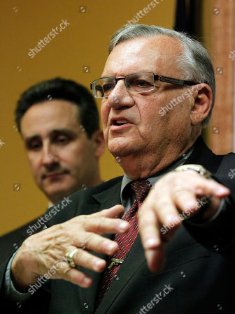 Joe Arpaio, Joseph Popolizio With one of his attorney's, Joseph Popolizio listening, Maricopa County Sheriff Joe Arpaio, answers questions regarding the Department of Justice announcing a federal civil lawsuit against Sheriff Arpaio and his department, during a news conference, in Phoenix. According to the Department of Justice, after months of negotiations failed to yield an agreement to settle allegations that the sheriff's department racially profiled Latinos in his trademark immigration patrols, the lawsuit was filed
