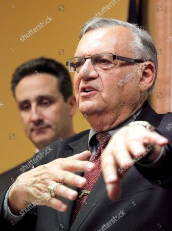 Joe Arpaio, Joseph Popolizio Maricopa County Sheriff Joe Arpaio, right, answers questions regarding the Department of Justice announcing a federal civil lawsuit against Sheriff Arpaio and his department, as his attorney listens Joseph Popolizio listening, during a news conference in Phoenix. The U.S. Justice Department is putting Arpaio on trial next month in a civil rights case that will focus in part on how the sheriff investigated and criminally charged people who crossed him from 2007 until 2010
