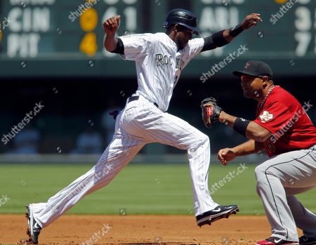 Dexter Fowler, Carlos Lee Colorado Rockies' baserunner Dexter Fowler, left, jumps back to first base as Houston Astros first baseman Carols Lee fields a pickoff throw in the first inning of game one of a day/night doubleheader in Denver on