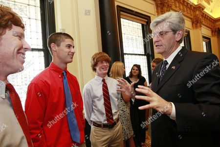 Phil Bryant, Matt Downing, Joseph South, Will Downing Mississippi Gov. Phil Bryant, discusses the problems he encountered before being diagnosed as having dyslexia with Canton Academy students, from left, Matt Downing, Joseph South and Will Downing, following his signing two bills designed to help dyslexia students, at the Capitol in Jackson, Miss. Both South and Will Downing suffer from dyslexia and were among several suffers who attended the signing. Bryant also signed a new education law and a law designed to give recognition to military veterans