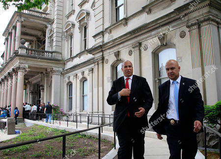 """Cory A. Booker Newark Mayor Cory A. Booker, left, walks from the Statehouse in Trenton, N.J., . When asked about tonight's New Jersey Devils-New York Rangers hockey playoff game, Booker said that the Devils """"are just peaking"""