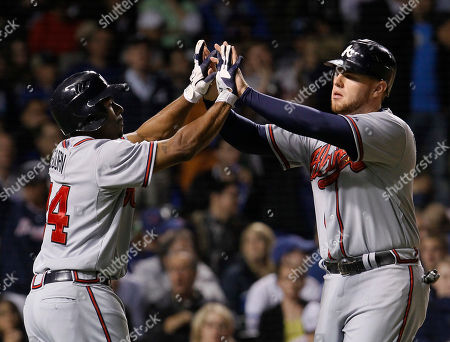 Michael Bourn, Freddie Freeman Atlanta Braves' Michael Bourn, left, and Freddie Freeman celebrate after scoring on a single by Dan Uggla off a pitch by Chicago Cubs relief pitcher Kerry Wood, during the eighth inning of a baseball game, in Chicago