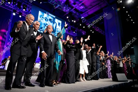 Stock Image of John Conyers, Charlie Rangel, John Lewis Reps. John Conyers, D-Mich., left, Charlie Rangel, D-N.Y., second from left, and Rep. John Lewis, D-Ga., third from left, along with other members of the Congressional Black Caucus Foundation's Phoenix Awards Dinner are recognized on stage at the Washington Convention center, in Washington