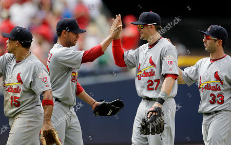 Eduardo Sanchez,Tyler Greene, Daniel Descalso St. Louis Cardinals relief pitcher Eduardo Sanchez, second from left, high-fives Tyler Greene (27) and Daniel Descalso after closing out the ninth inning in a baseball game against the Atlanta Braves, in Atlanta. St. Louis won 8-2