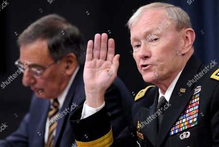 Leon Panetta, Martin Dempsey Defense Secretary Leon Panetta listens at left as Joint Chiefs Chairman Gen. Martin E. Dempsey speaks during a briefing at the Pentagon