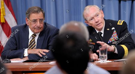 Leon Panetta, Martin Dempsey Defense Secretary Leon Panetta listens at left as Joint Chiefs Chairman Gen. Martin E. Dempsey speak during a briefing at the Pentagon