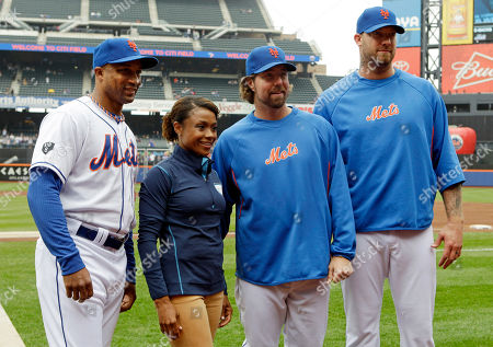 Dominique Dawes, R.A. Dickey, Jon Rauch Olympic gold medal-winning gymnast Dominique Dawes poses for photographs with New York Mets first base coach Tom Goodwin, left, starting pitcher R.A. Dickey, second from right, and relief pitcher Jon Rauch before a baseball game against the Arizona Diamondbacks, in New York