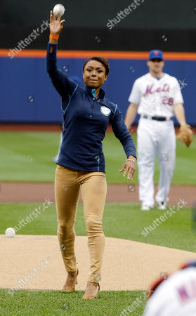 Dominique Dawes Olympic gold medal-winning gymnast Dominique Dawes throws the ceremonial first pitch before a baseball game between the New York Mets and the Arizona Diamondbacks, in New York