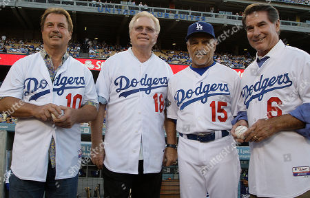 Ron Cey, Bill Russell, Davey Lopes, Steve Garvey The members of the Los Angeles Dodgers infield that played together from 1971 to 1983 are seen at Dodger Stadium . From left are Ron Cey, third base; Bill Russell, shortstop; Davey Lopes, second base; and Steve Garvey, first base. The four were honored with bobblehead night and threw out the ceremonial first pitches before a game against the Milwaukee Brewers at Dodger Stadium