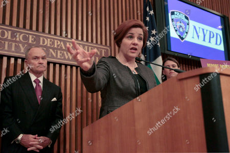 """Christine Quinn, Raymond W. Kelly City Council Speaker Christine Quinn, right, is joined by Police Commissioner Raymond W. Kelly during a news conference at Police headquarters, in New York. New York City officials are starting a new public campaign to help victims of domestic violence. Starting Tuesday, posters that say """"Report Domestic Violence. Call 911"""" will be plastered on buses and around neighborhoods where police say most domestic violence incidents occur. The posters were translated into Spanish and Russian"""