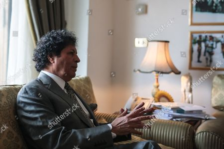 Ahmed Qaddaf al-Dam, cousin of Libya's former president Muammar Gaddafi, speaks during an interview at his apartment in Cairo, Egypt