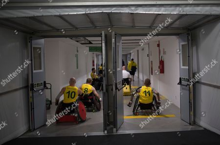 Stock Picture of Chris Bond, Ben Fawcett, Ryan Scott Australia's Chris Bond, Ben Fawcett and Ryan Scott make their way to the court for their team's wheelchair rugby group A match with Canada during the Paralympic Games in Rio de Janeiro, Brazil