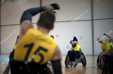 Ben Fawcett, Matt Lewis, Andrew Harrison Australia's Ben Fawcett, center, Matt Lewis, right, and Andrew Harrison stretch before their team's wheelchair rugby group A match with Canada during the Paralympic Games in Rio de Janeiro, Brazil