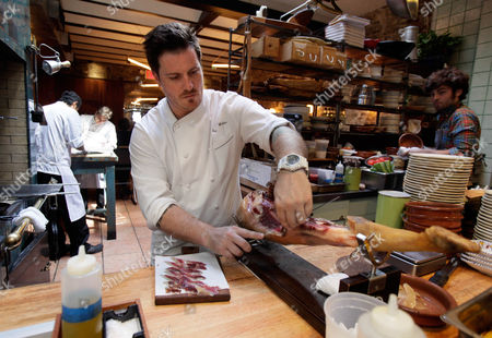 """Seamus Mullen Chef Seamus Mullen, owner of Spanish restaurant """"Tertulia,"""" carves a Jamon Iberico, in the kitchen of his restaurant in New York's Greenwich Village. Mullen is the author of the cookbook, """"Hero Food: How Cooking with Delicious Things Can Make Us Feel Better"""