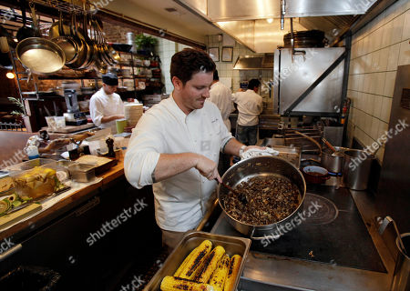 """Stock Photo of Seamus Mullen This photo shows chef Seamus Mullen, owner of Spanish restaurant Tertulia, stirring a pot of mushrooms in the kitchen of his restaurant in New York's Greenwich Village. Mullen is the author of the cookbook, """"Hero Food: How Cooking with Delicious Things Can Make Us Feel Better"""