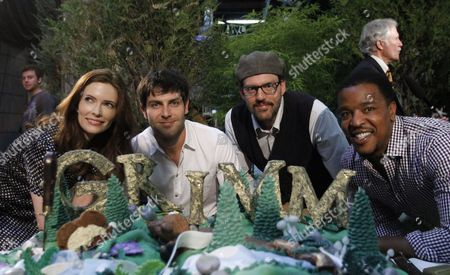 Bitsie Tulloch, David Giuntoli, Silas Weir Mitchell, Russell Hornsby The cast of the NBC television series Grimm pose with a cake to celebrate the kickoff for production of their second season in Portland, Ore., . Grimm, which is primarily filmed in Portland, helped create a record year for film and television production with over $130 million spent in Oregon. From left are Bitsie Tulloch, David Giuntoli, Silas Weir Mitchell and Russell Hornsby