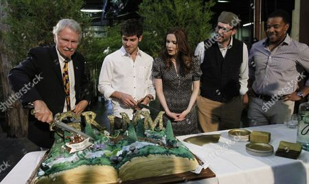 John Kitzhaber, David Giuntoli, Russell Hornsby, Bitsie Tulloch, Silas Weir Mitchell The case from the NBC television series Grimm watch as Oregon Gov. John Kitzhaber uses a large knife to cut a cak to celebrate the kickoff for production of their second season in Portland, Ore., . Grimm, which is primarily filmed in Portland, helped create a record year for film and television production with over $130 million spent in Oregon. From left are Kitzhaber, David Giuntoli, Bitsie Tulloch, Silas Weir Mitchell and Russell Hornsby