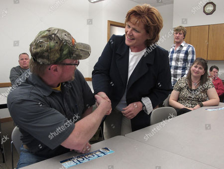 Democratic U.S. Senate candidate Heidi Heitkamp greets a supporter in Minot, N.D. Heitkamp's campaign says the North Dakota Democrat raised nearly $1 million in the second quarter of 2012. The former attorney general and one-time gubernatorial candidate, is running against Republican Congressman Rick Berg for the seat being vacated by retiring Democratic Sen. Kent Conrad