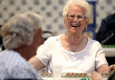 Stock Picture of Evelyn Maresca, Anna Anthony Evelyn Maresca, 83, right, laughs as she talks to Anna Anthony, 81, while playing bingo at a city sponsored cooling station at the Ironbound Senior Center, in Newark, N.J. Forecasters say temperatures could combine with humidity to make it feel like 110 degrees in parts of the state. Thermometers might not drop below 80 in the state's cities during the evening