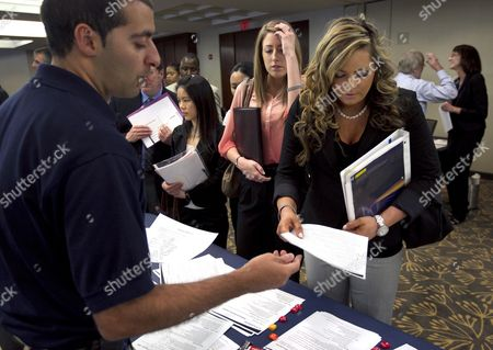 Jason Monteiro, Kathryn Williams Jason Monteiro, of Hudson, Mass., left, speaks with Kathryn Williams, of Salem, N.H., front right, during a job fair in Boston. Monteiro works for a health care technology company