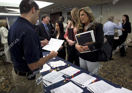 Jason Monteiro, Kathryn Williams Jason Monteiro, of Hudson, Mass., left, speaks with Kathryn Williams, of Salem, N.H., center right, during a job fair in Boston. Monteiro works for a health care technology company