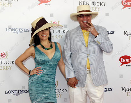 Stock Image of Comedian Ron White arrives with singer Margo Rey for the 138th Kentucky Derby horse race at Churchill Downs, in Louisville, Ky