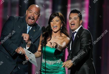 Mirella Grisales, Edgar Lopez, Karim Merinbu Award presenters Mirella Grisales, center, Edgar Lopez, left and and Karim Merinbu call out for the group Mana winners of the Latin Pop Album of the Year, during the Latin Billboard Awards in Coral Gables, Fla